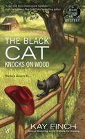 The Black Cat Knocks on Wood